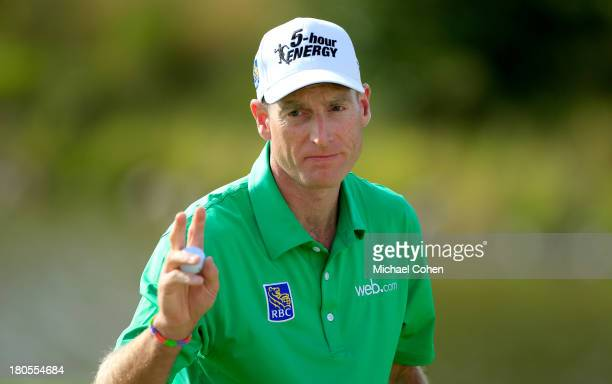 Jim Furyk waves after a birdie putt on the 15th green during the Third Round of the BMW Championship at Conway Farms Golf Club on September 14, 2013...