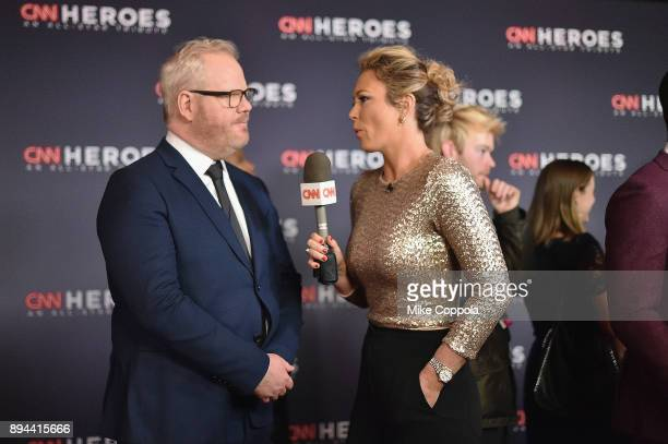Jim Gaffigan and Brooke Baldwin speak on the red carpet during CNN Heroes 2017 at the American Museum of Natural History on December 17, 2017 in New...