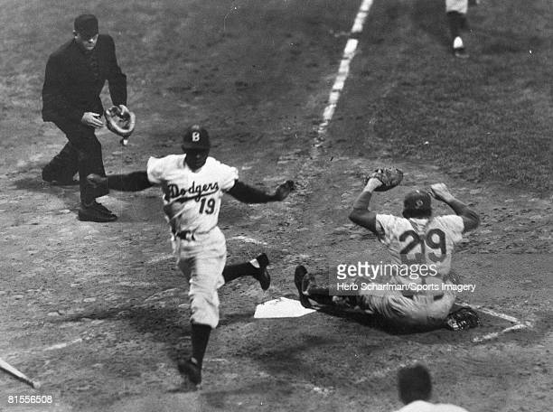 Jim Gilliam of the Brooklyn Dodgers crosses the plate during a MLB game against the Philadelphia Phillies in 1957 in Brooklyn New York