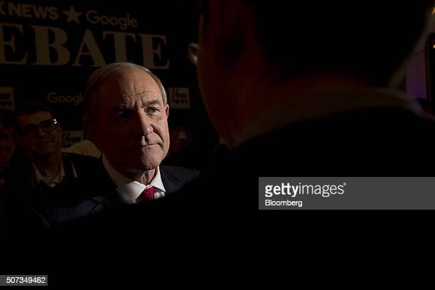 Jim Gilmore former governor of Virginia and 2016 Republican presidential candidate left talks to a member of the media in the spin room following the...