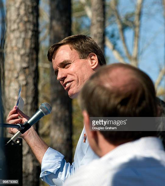 Jim Gilmore watches Mark Warner during the 60th Wakefield Shad Planking, April 16, 2008 in Wakefield, Virginia.