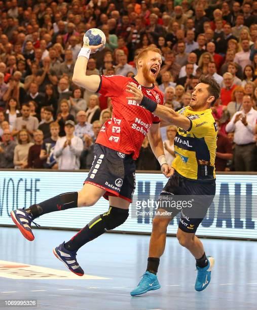 Jim Gottfridsson of SG FlensburgHandewitt is challenged by Alexander Petersson of RheinNeckar Loewen during the DKB HBL Bundesliga match between SG...