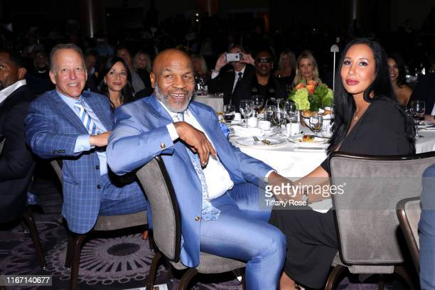 Jim Gray, Mike Tyson, and Lakiha Spicer attend the 19th Annual Harold and Carole Pump Foundation Gala at The Beverly Hilton Hotel on August 09, 2019...