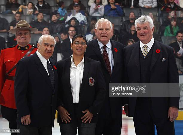 Jim Gregory, Angela James, Don Hay and Pat Quinn pose for photographs following the Hockey Hall of Fame blazer ceremony prior to the Legends Classic...