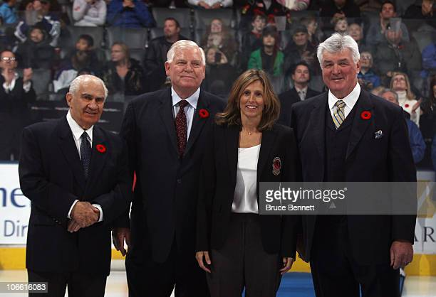 Jim Gregory Don Hay Cammi Granato and Pat Quinn pose for photographs following the Hockey Hall of Fame blazer ceremony prior to the Legends Classic...