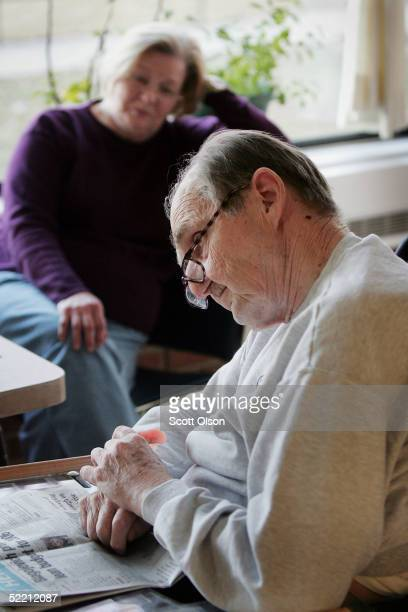 Jim Gwaltney a Korean War Air Force veteran sits with his wife Jewel at the Quincy Veterans Home February 16 2005 in Quincy Illinois The home with...