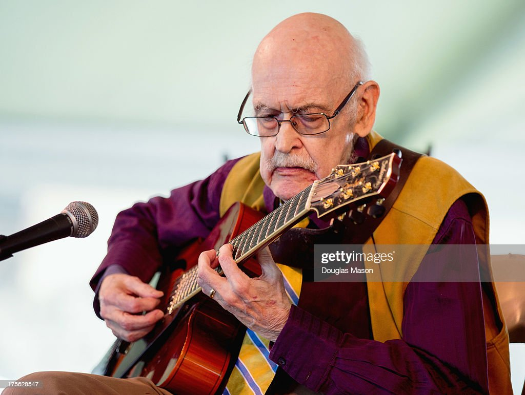 Jim Hall performs during the Newport Jazz Festival 2013 at Fort Adams State Park on August 4, 2013 in Newport, Rhode Island.