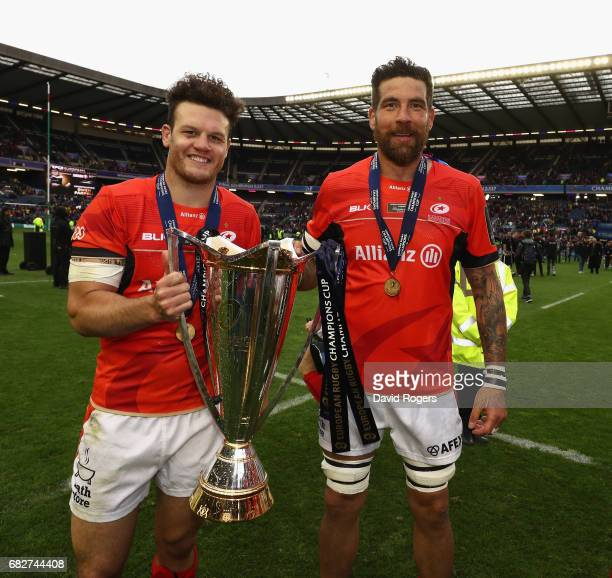 Jim Hamilton of Saracens celebrates with team mate Duncan Taylor after their victory during the European Rugby Champions Cup Final between ASM...