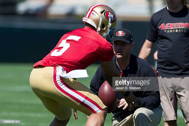 Jim Harbaugh head coach of the San Francisco 49ers instructs BJ Daniels during the San Francisco 49ers rookie minicamp at their training facility on...