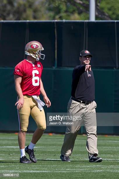 Jim Harbaugh head coach of the San Francisco 49ers instructs Nate Montana during the San Francisco 49ers rookie minicamp at their training facility...
