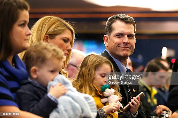 Jim Harbaugh looks on with his family as he is introduced as the new Head Coach of the University of Michigan football team at the Junge Family...