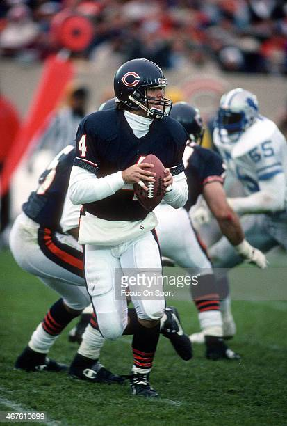 Jim Harbaugh of the Chicago Bears drops back to pass against the Detroit Lions during an NFL football game December 10 1990 at Soldier Field in...