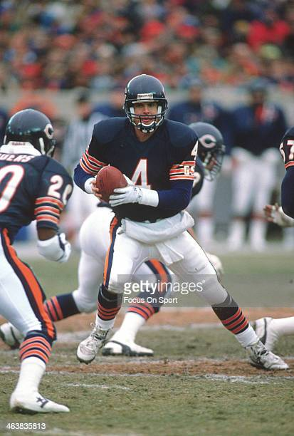 Jim Harbaugh of the Chicago Bears turns to hand the ball off against the Detroit Lions during an NFL football game December 10 1990 at Soldier Field...