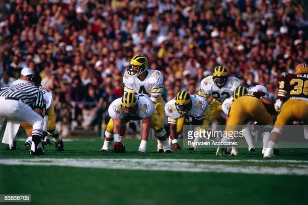 Jim Harbaugh of the Michigan Wolverines calls a play under center against the Arizona State Sun Devils during the Rose Bowl on January 1 1987 at the...