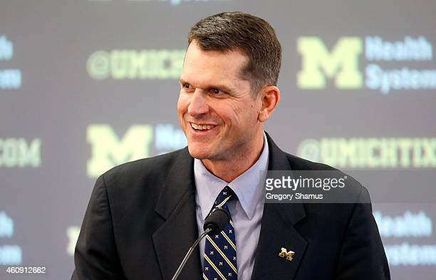 Jim Harbaugh speaks as he is introduced as the new Head Coach of the University of Michigan football team at the Junge Family Champions Center on...
