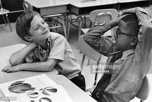 Jim Hard of Framingham and Joseph Reis of Roxbury get acquainted on their first day of school at the Trotter School in Boston Sept 3 1969