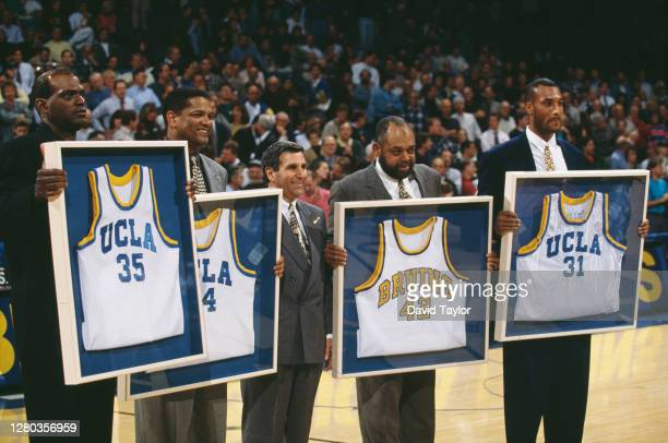 Jim Harrick, head coach stands with Sidney Wicks, Marques Johnson, Walt Hazzard and Ed O'Bannon, former players for the University of California, Los...