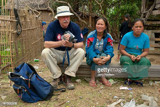 Jim Harris of Phoenix Clearance LTD talks with local women about VietnamWarera explosives they have found in their village over the years This sort...