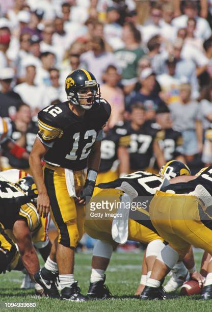 Jim Hartlieb, Quarterback for the University of Iowa Hawkeyes calls the play during the NCAA Big Eight Conference college football game against the...