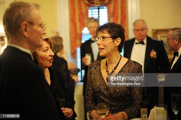 Jim Hartman, left, Francaise Straver, second from left, and Barbara Stansbury, have a conversation during the Monroe Dinner, a black-tie annual event...