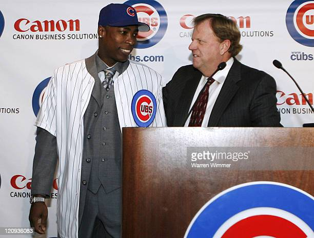 Jim Hendry General Manager of the Chicago Cubs turns the microphone over to the Cubs newly signed Alfonso Soriano for Q A at Wrigley Field Chicago...