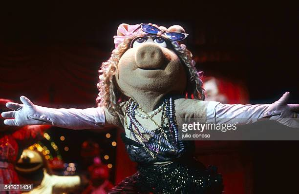 Jim Henson's Muppets visit London during The Muppet Show on Tour in 1987 Miss Piggy spreads her arms wide as she dances on stage