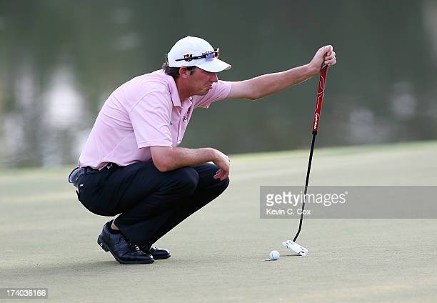 Jim Herman lines up his birdie putt on the 18th green during the second round of the Sanderson Farms Championship at Annandale Golf Club on July 19...