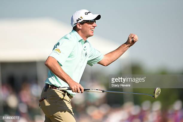 Jim Herman of the United States celebrates his victory on the 18th green during the final round of the Shell Houston Open at the Golf Club of...