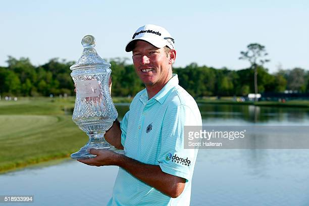 Jim Herman of the United States poses with the trophy after his victory at the Shell Houston Open at the Golf Club of Houston on April 3 2016 in...
