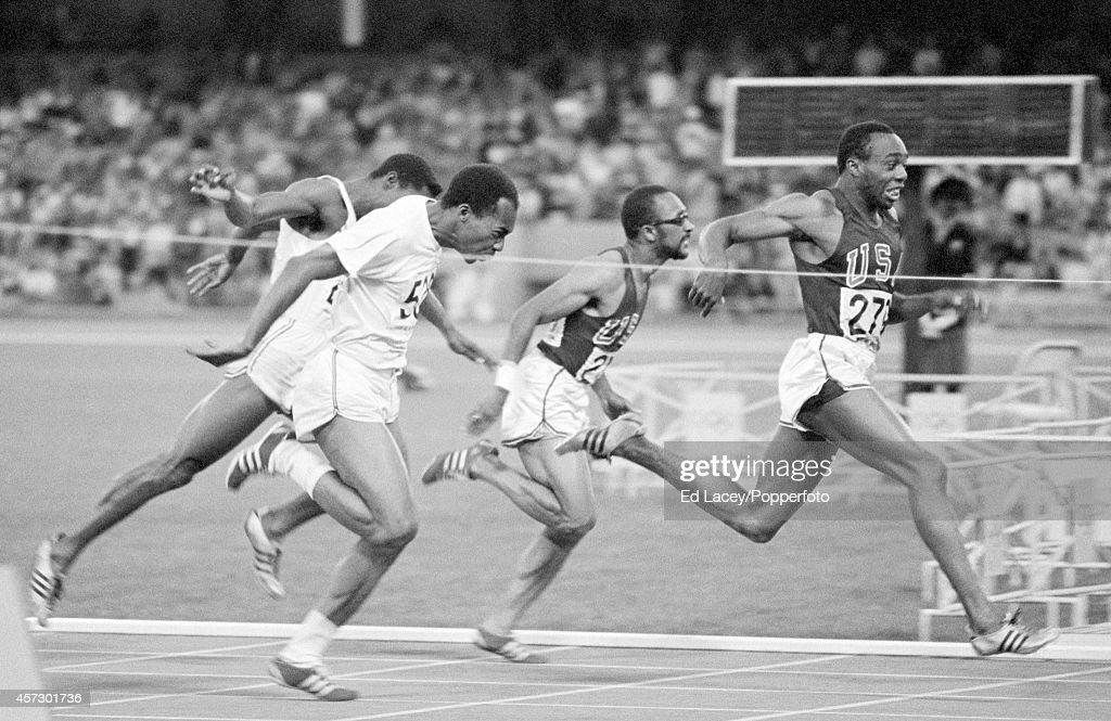 Jim Hines of the United States (right) wins the men's 100 metres in a world record time of 9.95 seconds during the Summer Olympic Games in Mexico City, circa October 1968.