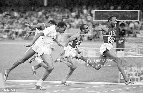 Jim Hines of the United States wins the men's 100 metres in a world record time of 995 seconds during the Summer Olympic Games in Mexico City circa...