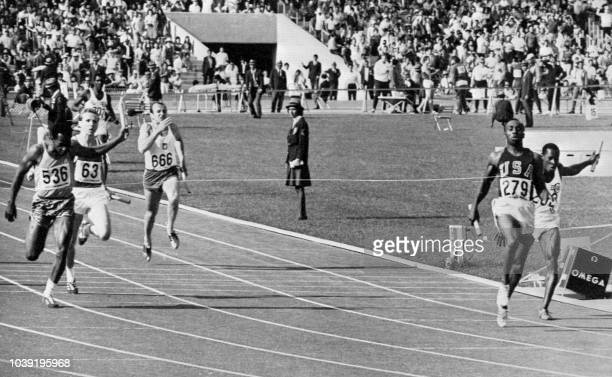 Jim Hines of the USA crosses the finish line to win the men's 4x100m relay final 21 October 1968 at the Mexico Olympic Games LR Lennox Miller Harald...