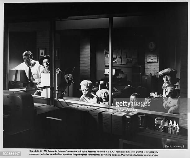 Jim Hutton Joey Bishop Dorothy Provine Milton Berle Jack Gilford and Walter Brennan hide in a scene from the Columbia Pictures movieWho's Minding the...