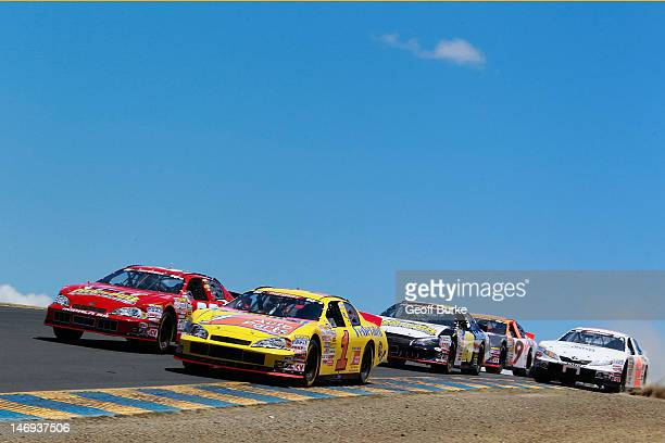 Jim Inglebright driver of the Federated Auto Parts Chevrolet leads Jessica Brunelli driver of the PickNPull Chevrolet during the NASCAR KN Pro Series...