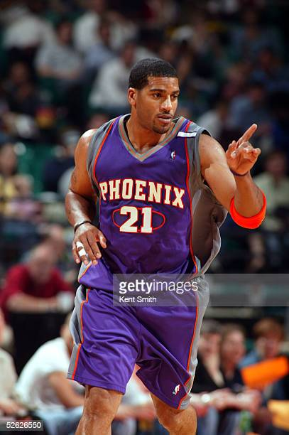 Jim Jackson of the Phoenix Suns gestures during the game against the Charlotte Bobcats at Charlotte Coliseum on March 23, 2005 in Charlotte, North...