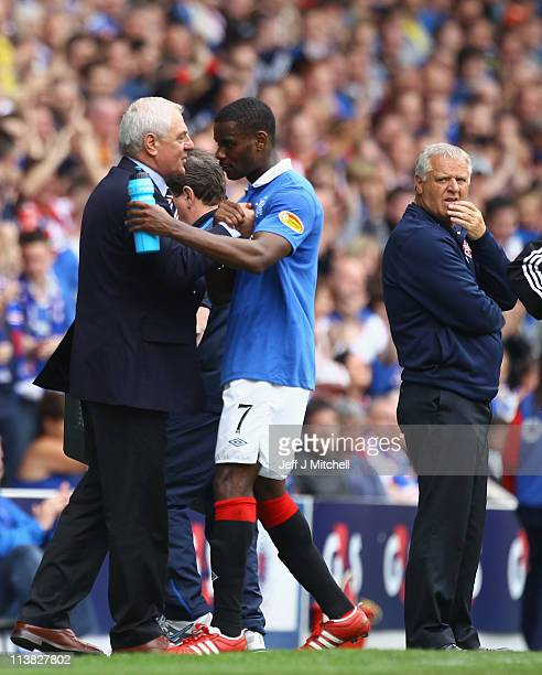 Jim Jefferies coach of Hearts looks on as Rangers coach Walter Smith shakes hands with Mayrice Edu during the Clydesdale Bank Premier League match...