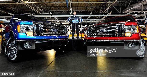 Jim Jenkins of Ford speaks to the media and employees while standing between two Ford F150 pickups at the Kansas City Ford Assembly plant October 2...