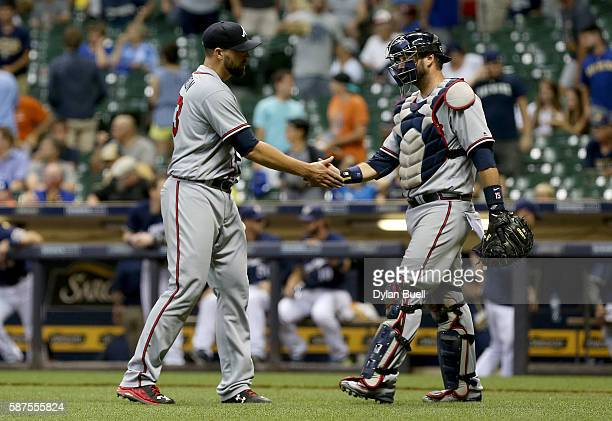 Jim Johnson and AJ Pierzynski of the Atlanta Braves celebrate after beating the Milwaukee Brewers 43 in 12 innings at Miller Park on August 8 2016 in...