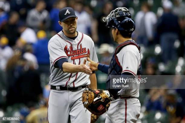 Jim Johnson and Kurt Suzuki of the Atlanta Braves celebrate after beating the Milwaukee Brewers 108 at Miller Park on April 28 2017 in Milwaukee...
