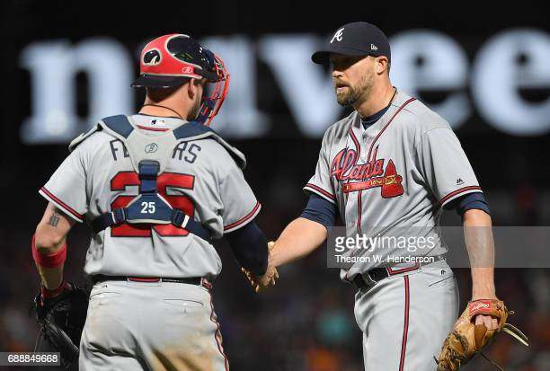 Jim Johnson and Tyler Flowers of the Atlanta Braves celebrates defeating the San Francisco Giants 20 at ATT Park on May 26 2017 in San Francisco...