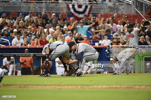 Jim Johnson Christian Bethancourt and Alberto Callaspo of the Atlanta Braves field the ball during the game against the Miami Marlins at Marlins Park...