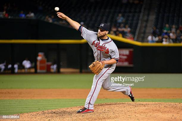 Jim Johnson of the Atlanta Braves delivers a pitch during the ninth inning against the Arizona Diamondbacks at Chase Field on August 23 2016 in...