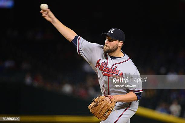 Jim Johnson of the Atlanta Braves delivers a pitch in the ninth inning against the Arizona Diamondbacks at Chase Field on August 25 2016 in Phoenix...