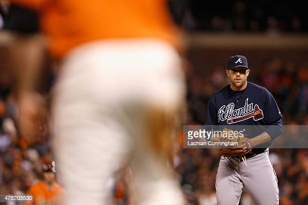 Jim Johnson of the Atlanta Braves looks to third base before pitching in the eighth inning against the San Francisco Giants at ATT Park on May 29...