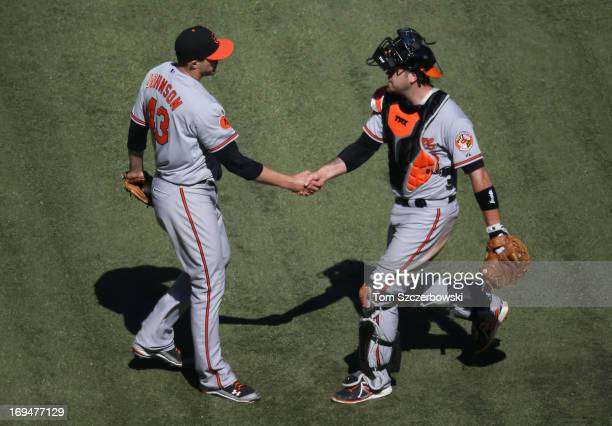 Jim Johnson of the Baltimore Orioles celebrates with Chris Snyder after their victory during MLB game action against the Toronto Blue Jays on May 25...