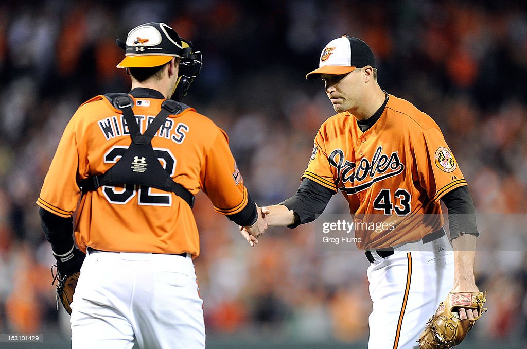 Jim Johnson #43 of the Baltimore Orioles celebrates with Matt Wieters #32 after a 4-3 victory against the Boston Red Sox at Oriole Park at Camden Yards on September 29, 2012 in Baltimore, Maryland.