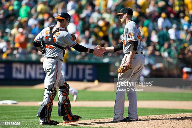 Jim Johnson of the Baltimore Orioles celebrates with Matt Wieters after the game against the Oakland Athletics at Oco Coliseum on April 27 2013 in...