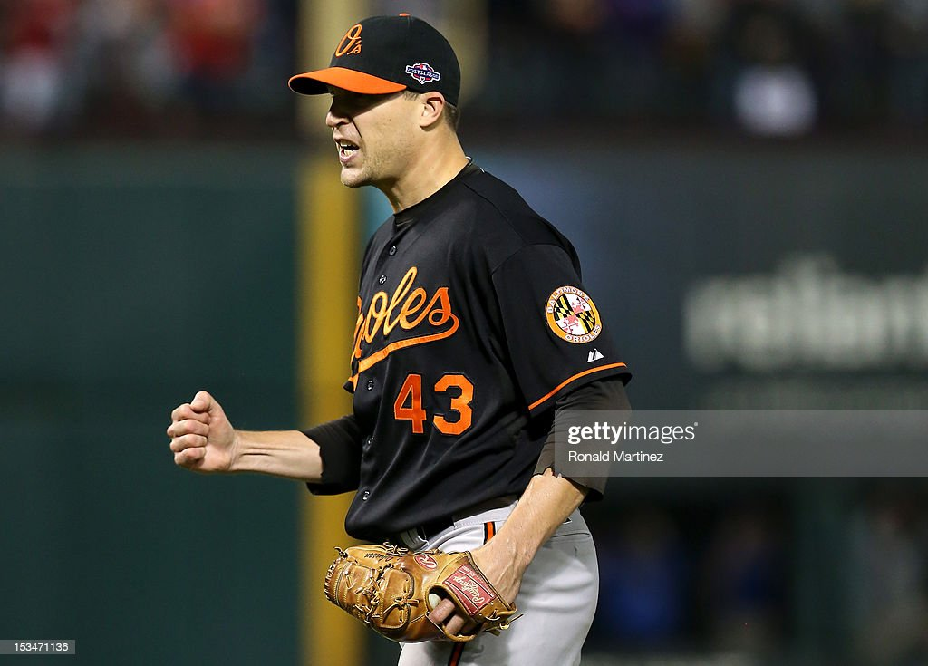 Jim Johnson #43 of the Baltimore Orioles reacts against the Texas Rangers in the ninth inning during the American League Wild Card playoff game at Rangers Ballpark in Arlington on October 5, 2012 in Arlington, Texas.