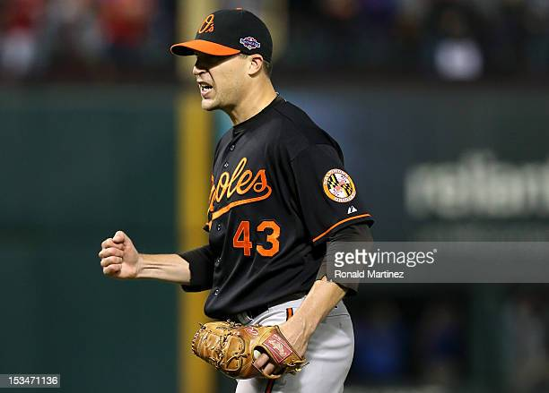 Jim Johnson of the Baltimore Orioles reacts against the Texas Rangers in the ninth inning during the American League Wild Card playoff game at...
