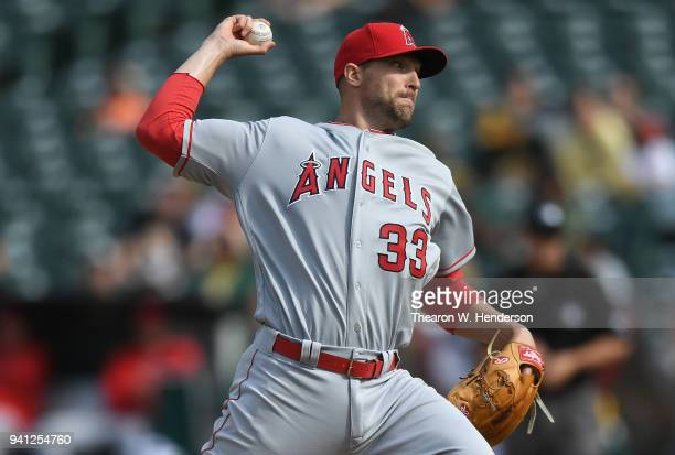 Jim Johnson of the Los Angeles Angels of Anaheim pitches against the Oakland Athletics in the bottom of the eighth inning at Oakland Alameda Coliseum...